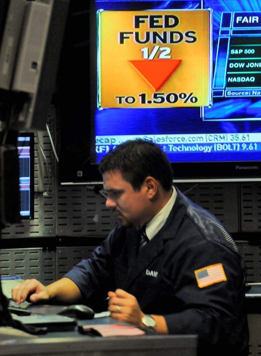 A television screen at the New York Stock Exchange shows the decision of the Federal Reserve to lower interest rates, Wednesday Oct. 8, 2008. The emergency cut led by the Federal Reserve will at least temporarily provide relief for investors who have been battered this week. (AP Photo/Richard Drew)