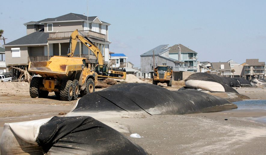 Erosion control devices line the beach in Galveston, Texas. The geotubes had been covered by dunes before Hurricane Ike hit the island last month. Many parts of Galveston remain littered with debris and are not ready to host the crowds that they usually attract. (Associated Press)