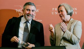 Paul Krugman, a Princeton University professor of economics and a New York Times columnist, is applauded by Princeton President Shirley M. Tilghman after winning the Nobel Prize in economics. (Associated Press) ** FILE **