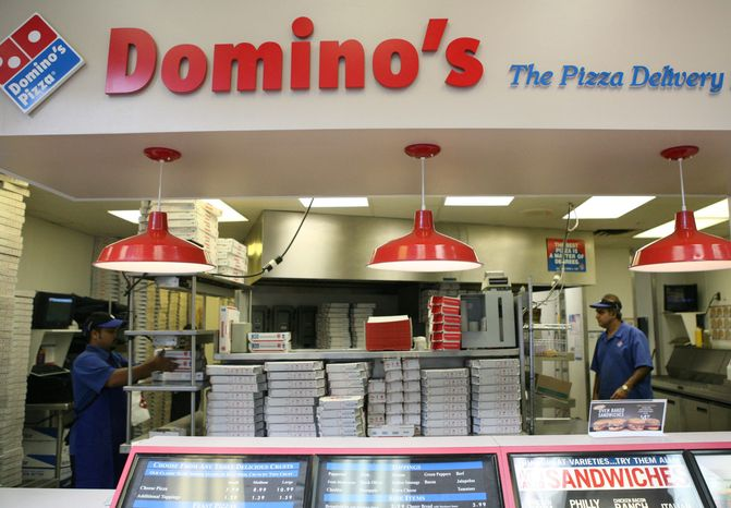 Sohel Islar (left) and Malak Khan work behind the counter at a Domino's Pizza store in Arlington in 2008. (The Washington Times) ** FILE **