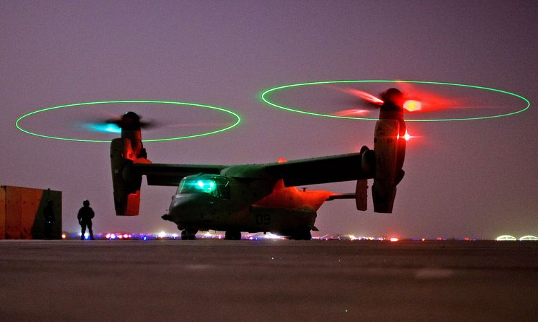A V-22 Osprey tilt-rotor aircraft taxies after a mission at Asad Air Base in western Iraq. (Associated Press) ** FILE **