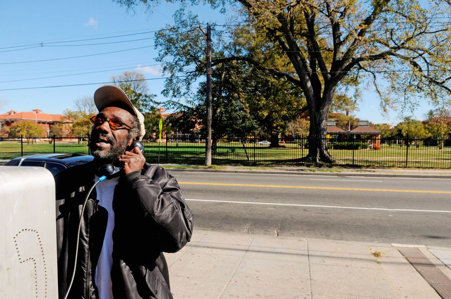 Alan Favors, 56, makes a call at a pay phone outside the Circle B Convenient Store, across the street from the east side of St. Elizabeth's Hospital on Martin Luther King Jr. Avenue in Southeast Washington, on Oct. 22, 2008. (Mary F. Calvert/The Washington Times)
