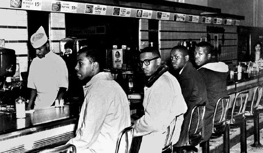 From left, four North Carolina A&T State University students, Joseph McNeil, Franklin McLain, Billy Smith and Clarence Henderson, sit at the all-white lunch counter of an F.W. Woolworth Co. store on Feb. 2, 1960, in Greensboro, N.C. The incident helped energize the Civil Rights movement. (Jack Moebes/Greensboro News & Record via Associated Press) ** FILE **
