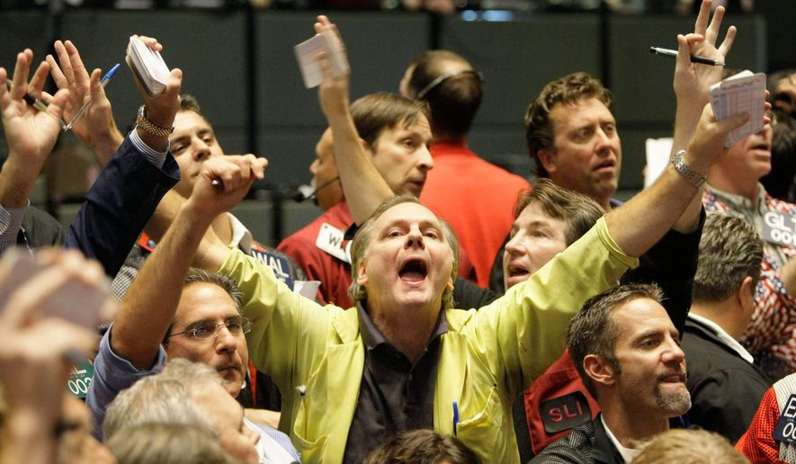 Traders signal in the CME Group's S&P 500 futures pit in Chicago Wednesday shortly after the Federal Reserve cut interest rates by a half-point.