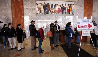 Residents line up to cast their absentee ballots early at the D.C. Board of Elections.
