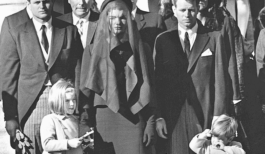 NOVEMBER 26: Jacqueline Kennedy stands with her two children Caroline Kennedy and John F. Kennedy, Jr and brothers-in law Ted Kennedy (L, back) and Robert Kennedy (R) at the funeral of her husband US President John F. Kennedy 26 November 1963 in Washington, DC. A plane piloted by John F. Kennedy, Jr. was missing 17 July 1999 after departing from a small airport near New York City en route to Martha's Vineyard, MA. (Photo credit should read STAFF/AFP/Getty Images)