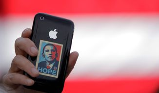 A supporter displays an iPhone during a rally for Sen. Barack Obama in Raleigh, N.C., on Oct. 29, 2008. Sen. Joseph R. Biden Jr.'s very selection as running mate was officially announced to the world through a telephone text message. (Associated Press) **FILE**