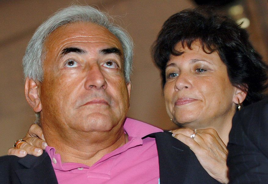 ** FILE ** Dominique Strauss-Kahn, managing director of the International Monetary Fund, is shown with his wife, Anne Sinclair, a well-known television personality in France, in 2006. (AP Photo, File)