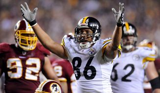 Pittsburgh Steelers wide receiver Hines Ward (86) celebrates a first-down reception during the second quarter of the Steelers' 23-6 road win Monday over the Washington Redskins. (Peter Lockley/The Washington Times)