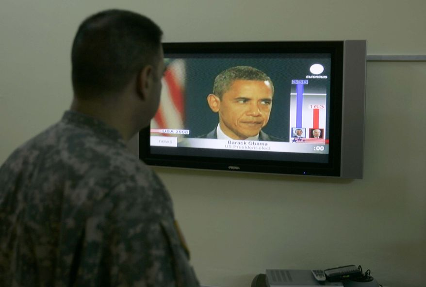 A U.S soldier watches on TV a news image of U.S. President-elect Barack Obama, in Baghdad, Iraq, on Wednesday, Nov. 5, 2008. Many in Iraq said Wednesday they don't expect an immediate shift in U.S. policy toward their country when Barack Obama takes over as the new U.S. president, despite his calls for a complete withdrawal of U.S. troops within 16 months.