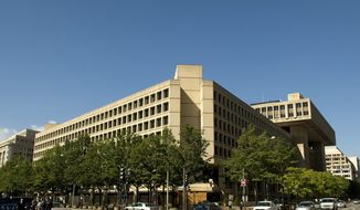 **FILE** The Federal Bureau of Investigation's D.C. headquarters (The Washington Times)