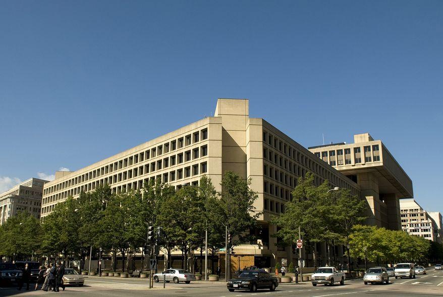 **FILE** The Federal Bureau of Investigation's D.C. headquarters (The Washington Times)
