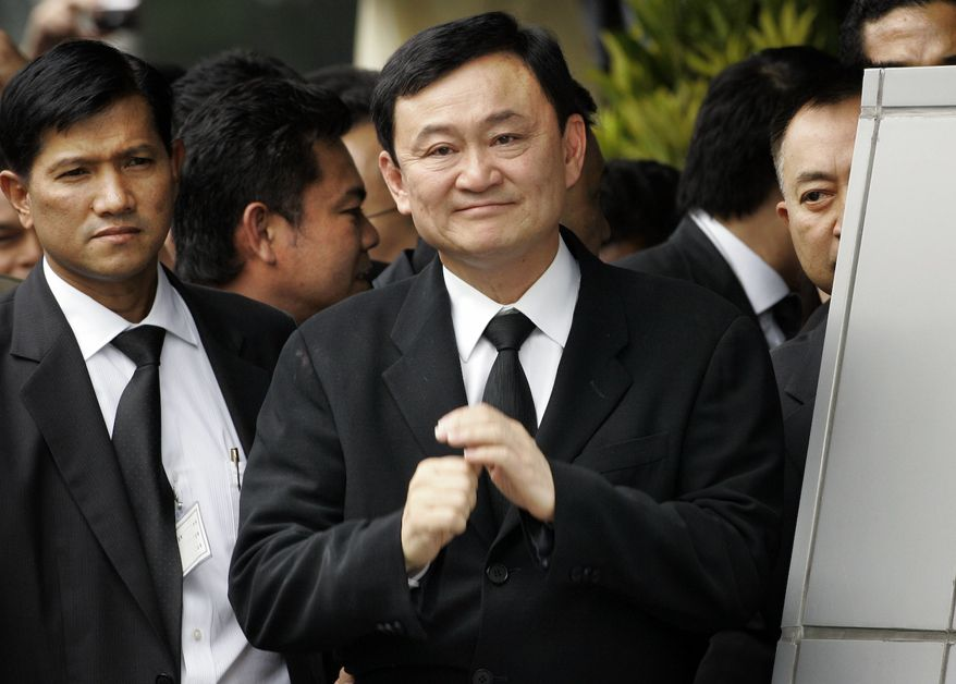 **FILE** In this photo from February 2008, former Thailand Prime Minister Thaksin Shinawatra smiles as he greets supporters a the Bangkok airport on his return from exile. (Associated Press)
