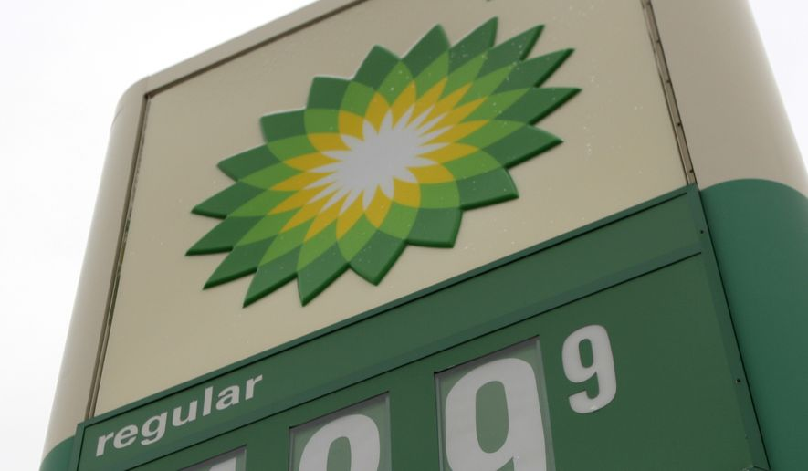 The sign in front of a BP gas station in Brunswick, Ohio, shows the price of one gallon of unleaded regular gasoline to be $1.89.9 on Monday, Nov. 10, 2008. Oil prices fell to near an 18-month low of $60 a barrel Tuesday as hopes waned that a huge Chinese spending plan will do much to avert a prolonged slowdown in the global economy.