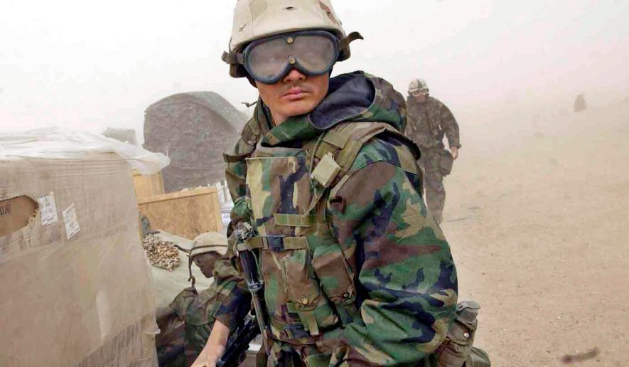 Marines of the 1st Force Service Supply Group Forward respond to reports of an Iraqi force preparing to advance on them from the south during a sandstorm in southern Iraq on March 25, 2003. President Bush's legacy depends on a positive outcome in Iraq. (J.M. Eddins Jr./The Washington Times)