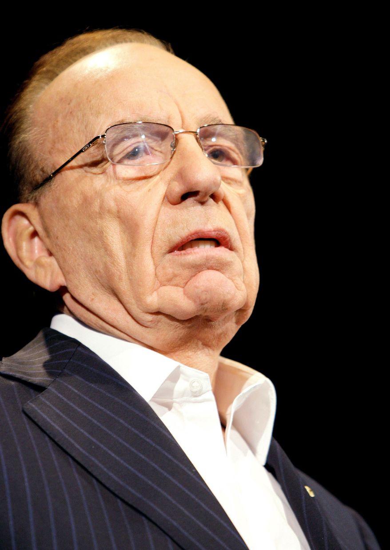 "ASSOCIATED PRESS Doomsayers predicting the Internet will kill newspapers are ""misguided cynics,"" says media mogul Rupert Murdoch, chairman of News Corp."