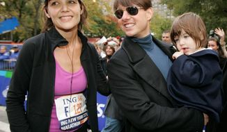 ** FILE ** Katie Holmes and Tom Cruise are pictured with their daughter, Suri, in 2008.