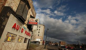 Shuttered businesses line a downtown street November 20, 2008 in Detroit, Michigan. An estimated one in three Detroiters lives in poverty, making the city the poorest large city in America. The Big Three U.S. automakers, General Motors, Ford and Chrysler, are appearing this week in Washington to ask for federal funds to curb to decline of the American auto industry. Detroit, home to the big three, would be hardest hit if the government lets the auto makers fall into bankruptcy.  (Photo by Spencer Platt/Getty Images)