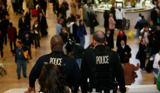GETTY IMAGES Police keep watch in Grand Central Terminal on Wednesday in New York. The FBI and Homeland Security Department downplayed the seriousness of a terrorist threat to transit systems.