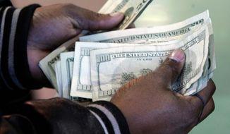 *FILE* U.S. dollars. April 5, 2009