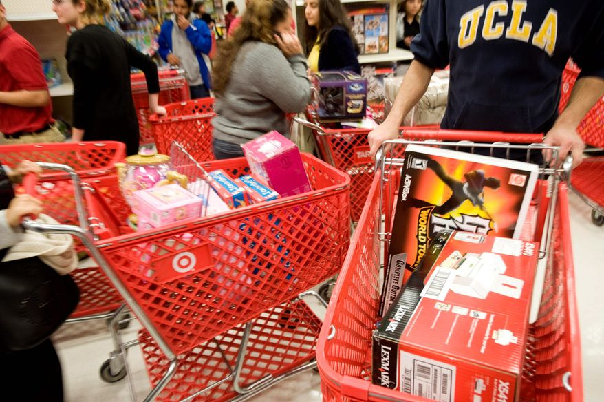 ** FILE ** Aisles near the electronics section (left) were gridlocked as shoppers hustled to find deals at a West Hollywood, Calif., Target store. (Associated Press)