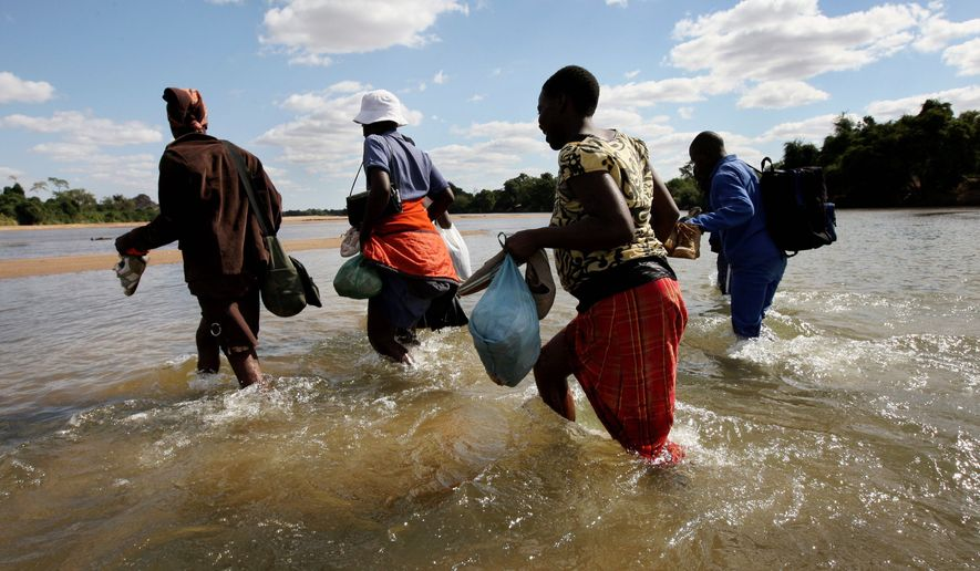 An estimated 1,200 undocumented migrants daily cross the Limpopo River, South Africa's equivalent of the Rio Grande separating the U.S. and Mexico. Most are from Zimbabwe, where shortages of food and fuel and an unemployment rate of more than 80% have sparked a steady exodus to the more stable and more prosperous South Africa. (Getty Images/File)