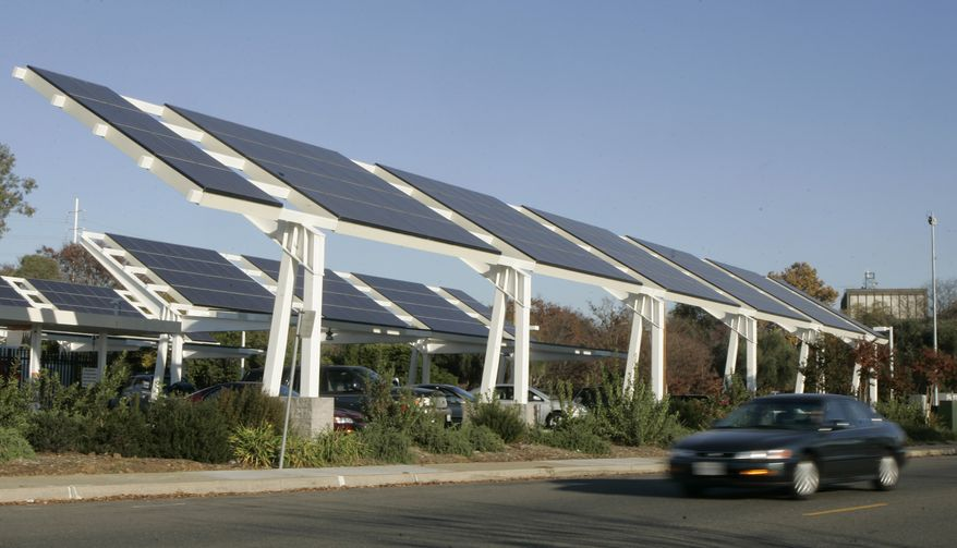** FILE ** Solar panels are seen outside the offices of the Sacramento Municipal Utility District in Sacramento, Calif., Wednesday, Dec. 10, 2008. (Associated Press)