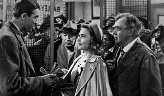 "James Stewart (left), Donna Reed and Thomas Mitchell appear in ""It's a Wonderful Life."""