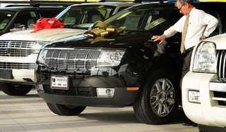 **FILE** Sport utility vehicles sit at a Lincoln Mercury dealership in Northern Virginia on Dec. 17, 2008. (The Washington Times)