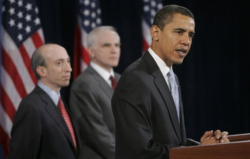 President-elect Barack Obama (right) announces Federal Reserve Board Governor-designate Daniel Tarullo (center) and Commodities Futures Trading Commission Chairman-designate Gary Gensler in Chicago on Thursday, Dec. 18, 2008. (AP Photo/Lawrence Jackson)