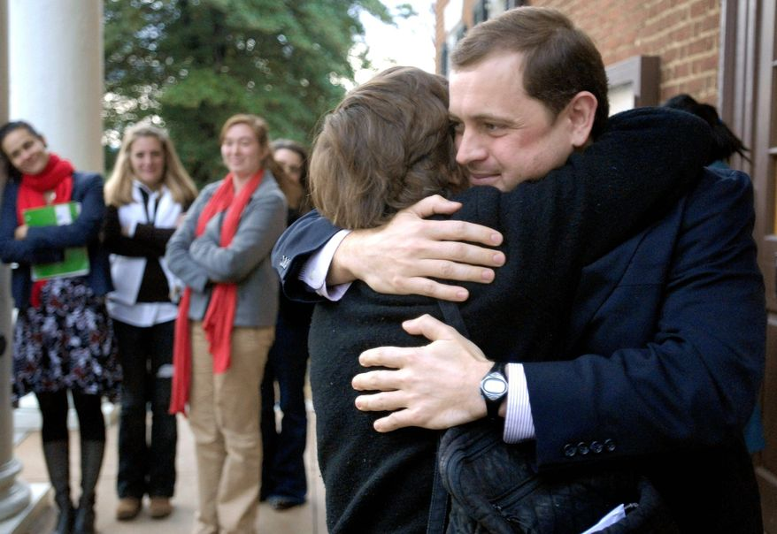 ASSOCIATED PRESS Virginia's Democratic Congressman-elect Tom Perriello hugs his mother, Linda, following the certification of his election victory over incumbent Republican Virgil H. Goode Jr. at the Albemarle County District Courthouse on Wednesday.