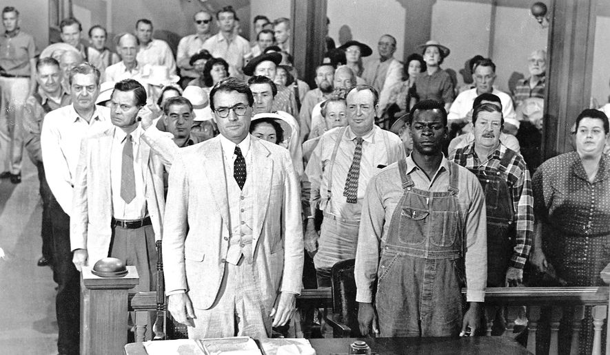 "This picture provided by Universal Studios Home Entertainment shows actors Gregory Peck, foreground left, and Brock Peters, foreground right, in a scene from the 1962 film ""To Kill a Mockingbird."" (Associated Press) ** FILE **"