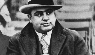 Mobster Al Capone, here in 1931, got away with gambling and selling alcohol during Prohibition because he had a tight grip on City Hall. His men were known to roam the building looking for favors. (Associated Press)