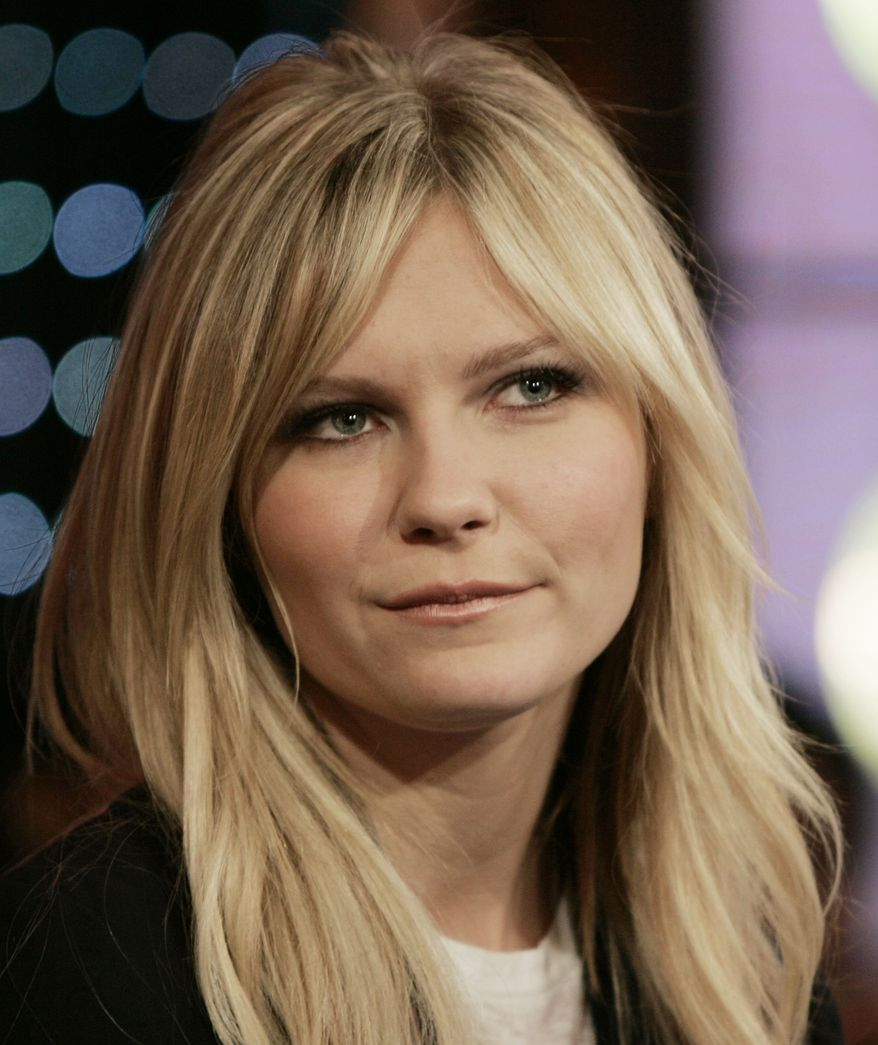 "Actress Kirsten Dunst, appears on stage during MTV's ""Total Request Live"" show at the MTV Times Square Studios, Wednesday, Oct. 18, 2006, in New York. Dunst's new film ""Marie Antoinette,"" opens Friday. (AP Photo/Jeff Christensen)"