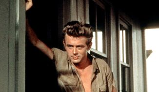 "Actor James Dean, shown in a scene from the 1956 movie ""Giant,"" exemplified the bad-boy persona. (Associated Press)"
