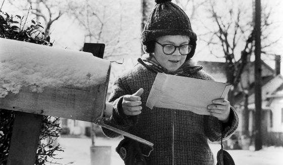 "Ralphie (Peter Billingsley) rushes home from school and finds his long-awaited secret decoder ring in the mail box in ""A Christmas Story."""