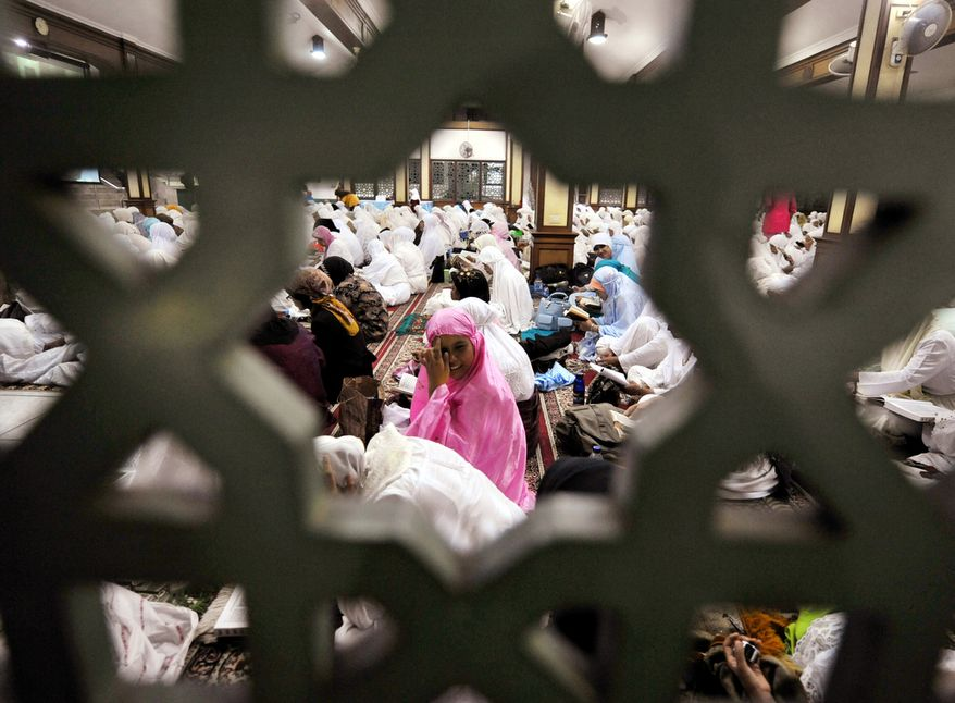 """Despite the month's religious roots, Muharram today is """"more of a cultural holiday,"""" said Imam Johari Abdul-Malik, director of outreach at the Dar Al-Hijrah Islamic Center in Falls Church, Virginia.. """"Think of it as a new year, as a new beginning to make resolutions."""" (ADEK BERRY/AFP/Getty Images)"""