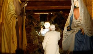 ** FILE ** Pope Benedict XVI visits the Nativity scene after a New Year's Eve Vespers service at St. Peter's Basilica at the Vatican in 2008.
