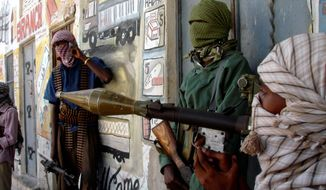 Al-Shabaab insurgents gather with arms in Mogadishu. (Associated Press) **FILE**