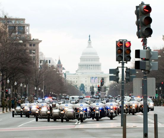 ** FILE ** A formation of police motorcycles leads the dress rehearsal of the inauguration parade in 2009. (Michael Connor / The Washington Times)