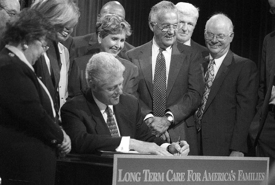 President Clinton is surrounded by several members of Congress who supported the Long-Term Care Security Act as he signs it into law in September 2000.