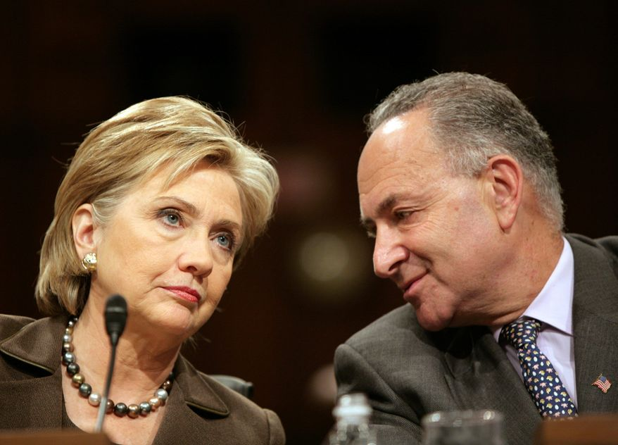 ** FILE ** Then-Sen. Hillary Rodham Clinton confers with Sen. Charles E. Schumer before her confirmation hearing for secretary of state on Tuesday, Jan. 13, 2009. (The Washington Times)