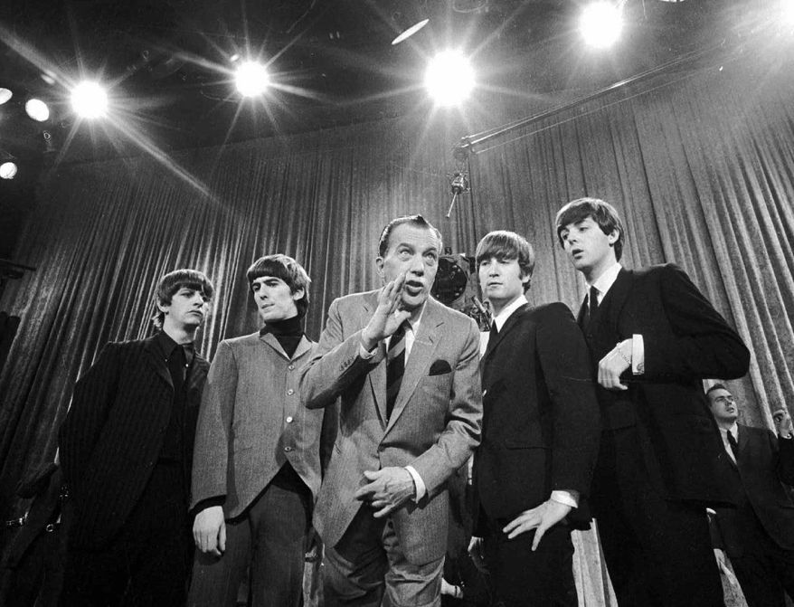 Ed Sullivan rehearses with the Beatles (from the left: Ringo Starr, George Harrison, John Lennon and Paul McCartney) for their Feb. 9, 1964, appearance on his CBS variety show. The program, the Beatles' first U.S. performance, is among TV's most memorable live-music moments. (Associated Press)