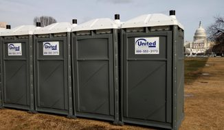 ** FILE ** A row of portable toilets line the National Mall near the Capitol in Washington, Monday, Jan. 12, 2009. (AP Photo/Jacquelyn Martin)