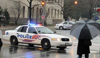 ** FILE ** A Metropolitan Police cruiser in downtown Washington (The Washington Times)