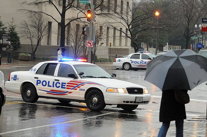 ** FILE ** A Metropolitan Police cruiser in downtown Washington (The Washington Times)