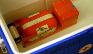 """The cockpit voice recorder -- one of the two """"black boxes"""" -- of US Airways Flight 1549 is displayed early Sunday, Jan. 18, 2009, in New York. Salvage crews successfully hoisted the downed jetliner from the Hudson River late Saturday. (AP Pool Photo/Edouard H.R. Gluck)"""