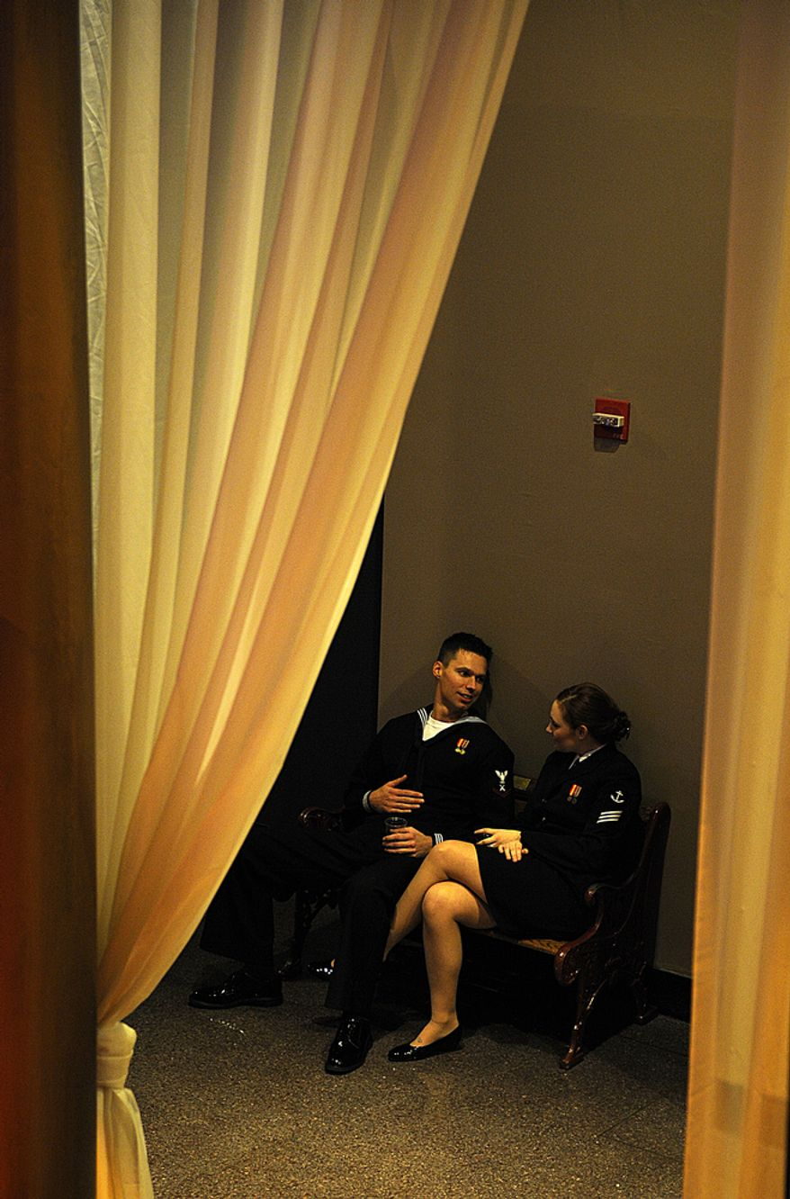 Two Navy officers chat in a corner of the National Building Museum, which hosted the Commander-in-Chief's Ball on Tuesday. The Commander-in-Chief's Ball honors men and women in the military. (Barbara L. Salisbury/The Washington Times)