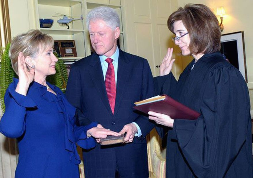AGENCE FRANCE-PRESSE/GETTY IMAGES Associate Judge Kathleen Oberly swears in Hillary Rodham Clinton as secretary of state Wednesday with her husband, former President Bill Clinton, on hand. Mrs. Clinton, who has been the junior senator from New York, won Senate confirmation in a 94-2 vote.
