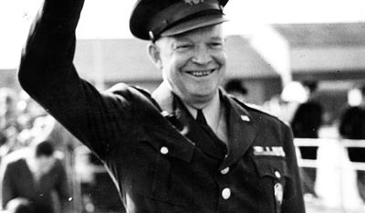16th March 1952: General Dwight D Eisenhower (1890-1969) waves to a crowd of spectators before leaving to go to Paris, France. Eisenhower was later elected the 34th President of the United States. (Photo by Topical Press Agency/Getty Images)